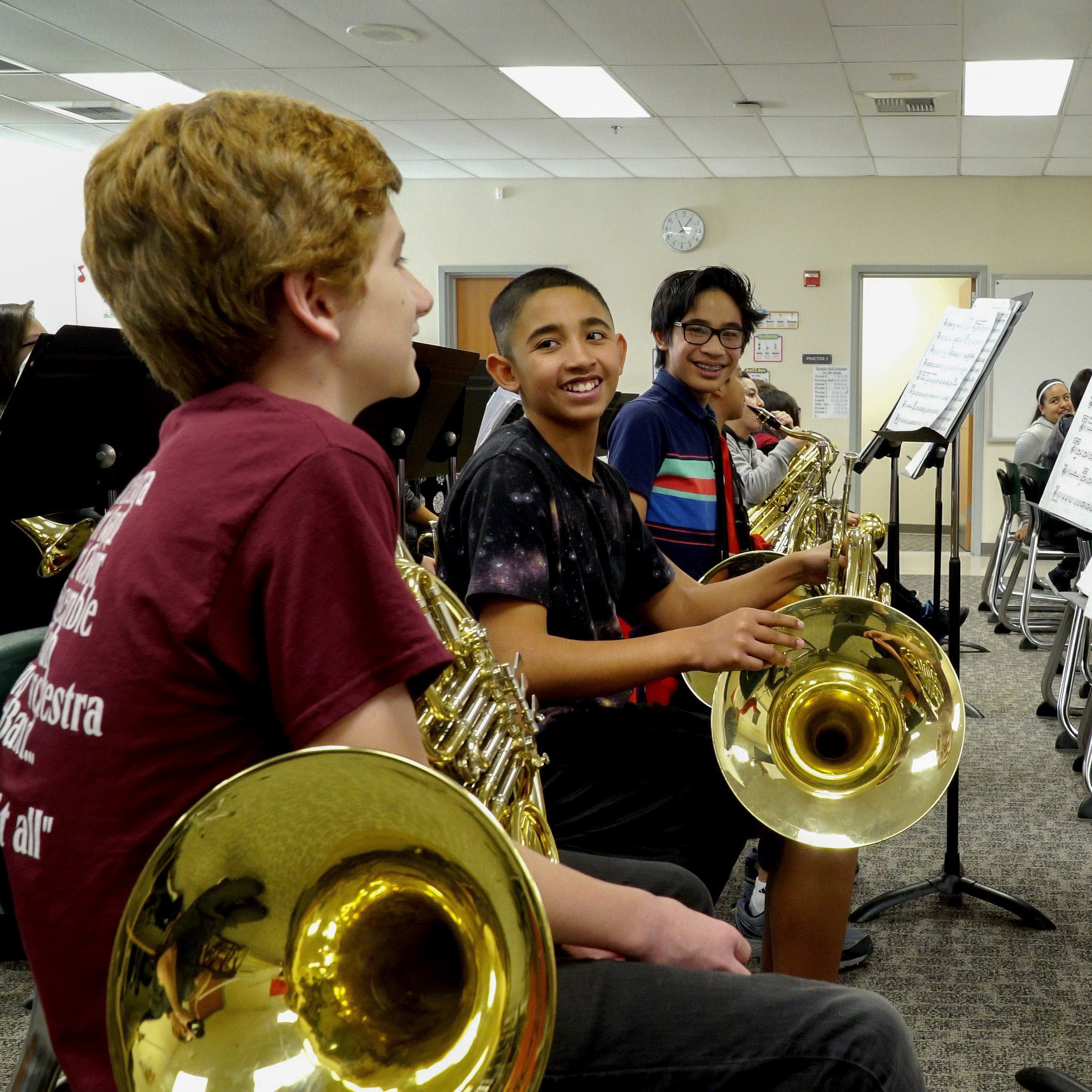 Middle school children playing instruments.