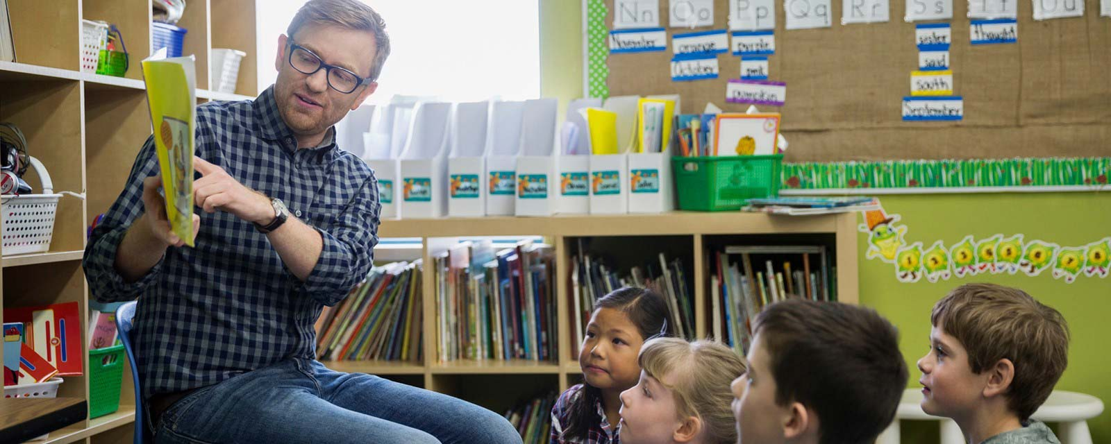 A Teacher reading to young students